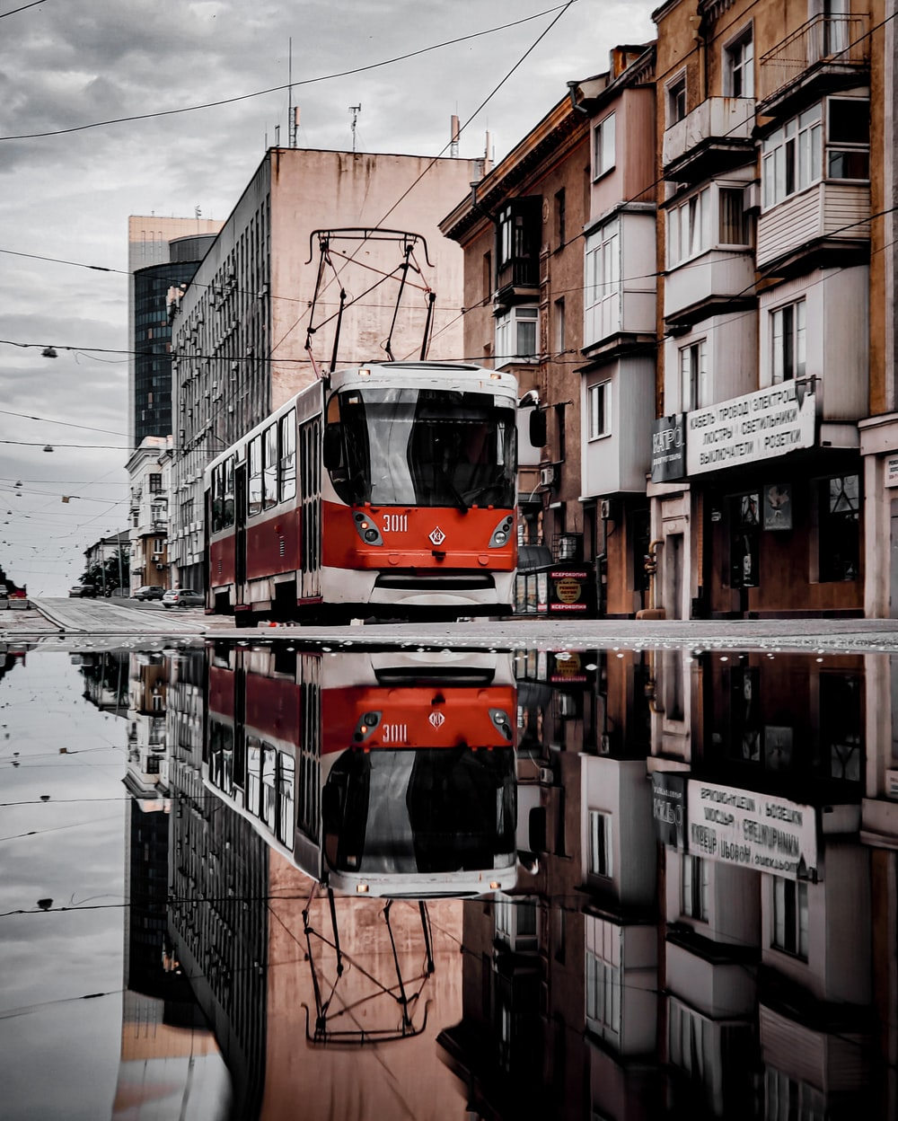 red and white bus near buildings