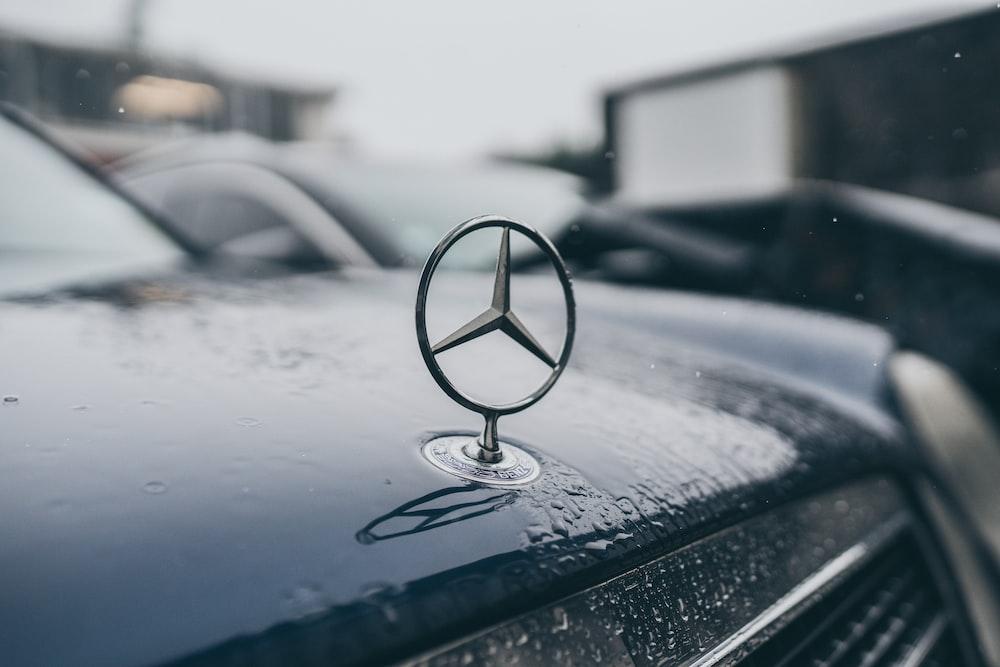 gray stainless steel Mercedes-Benz emblem
