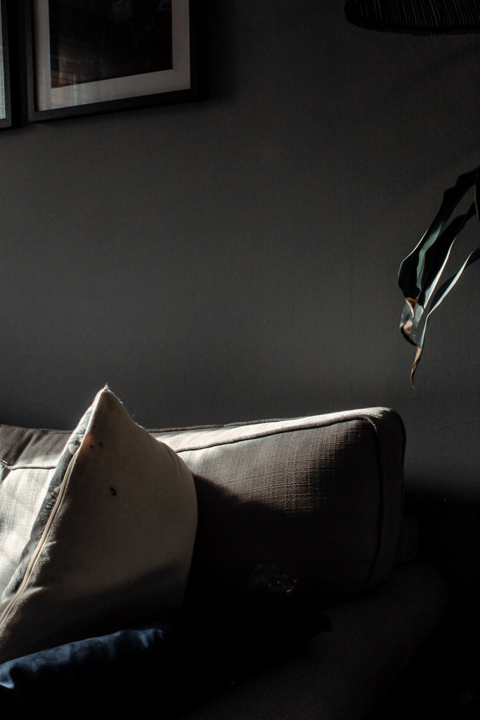 gray fabric padded sofa