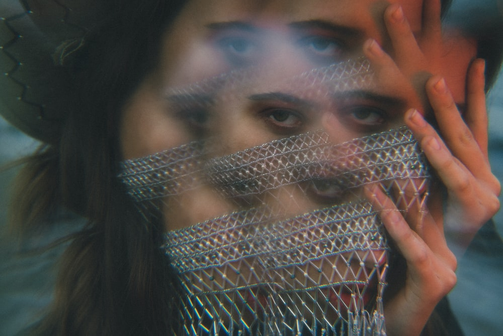 woman wearing gray mesh scarf