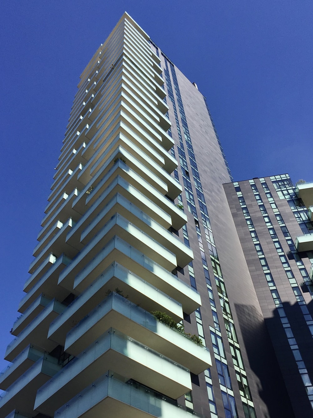low-angle photography of gray high-rise building during daytime