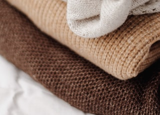 assorted-color knitted textiles