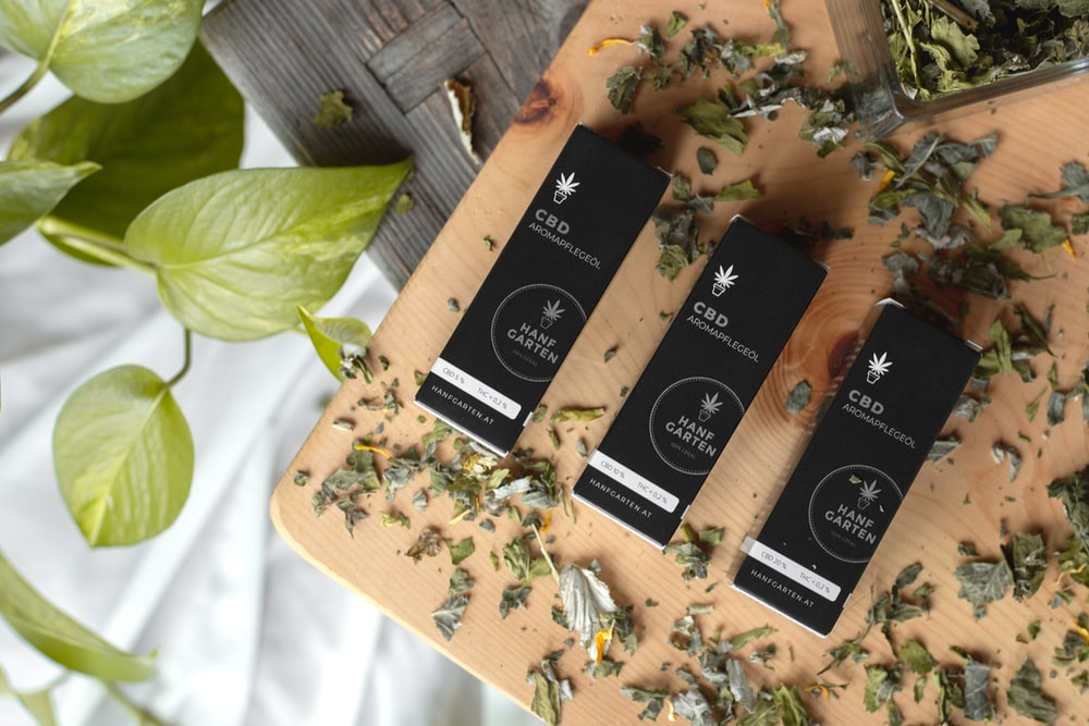 three CBD boxes near chopped herbs