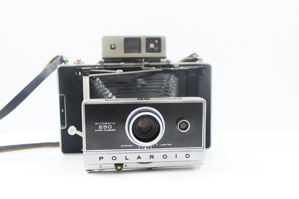 black and silver Polaroid folding camera