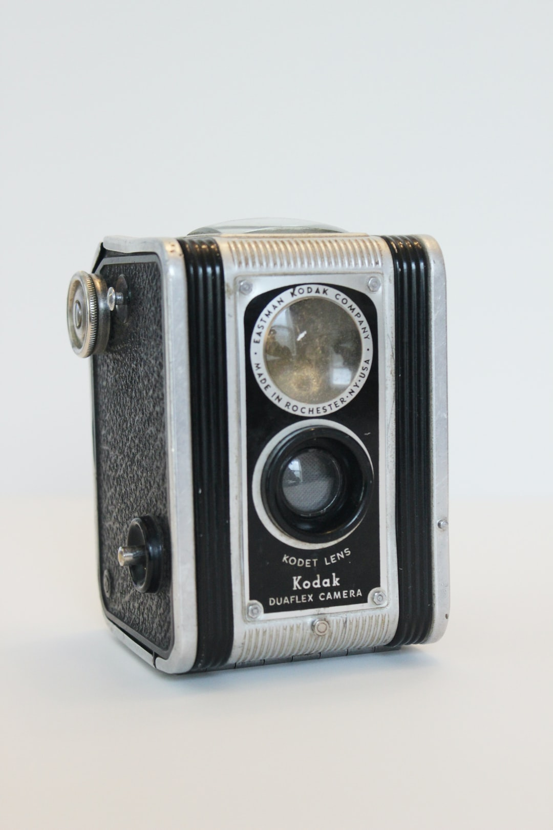 Vintage Kodak Duaflex Camera on gray background.