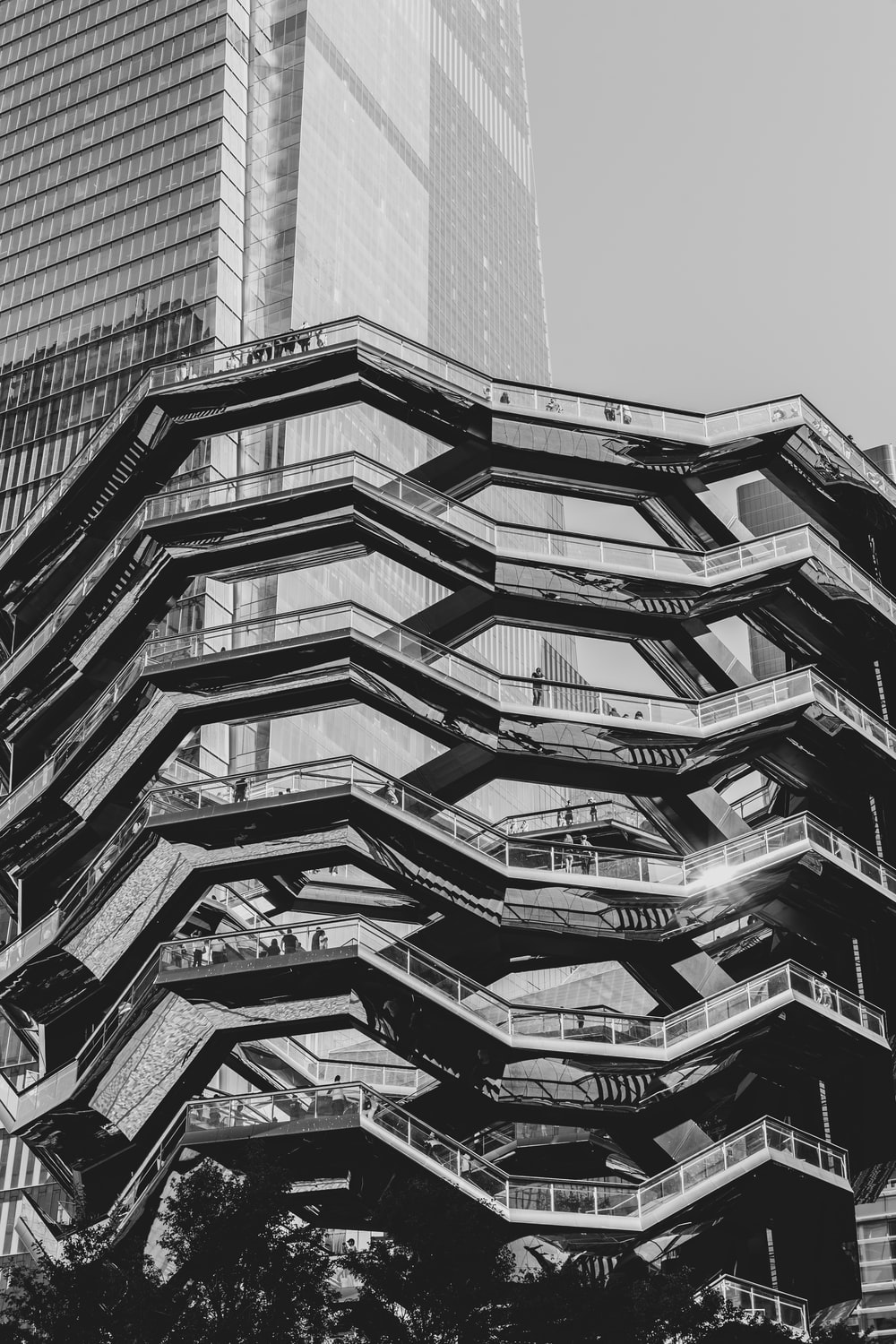 grayscale photography of black and gray building