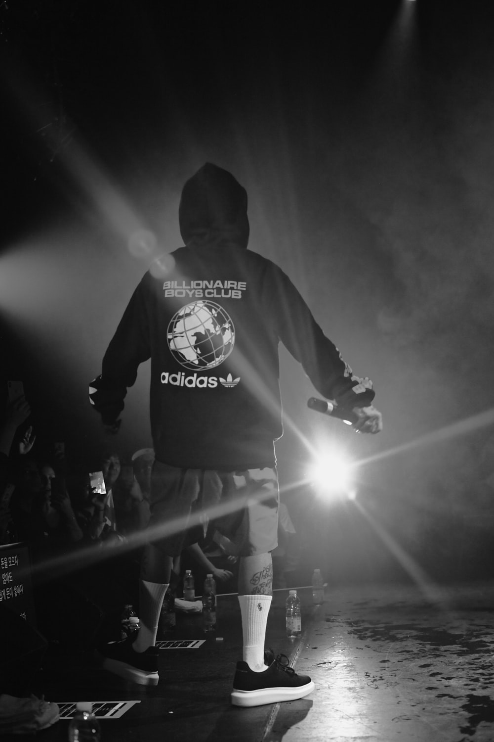 grayscale photography of man in pullover hoodie