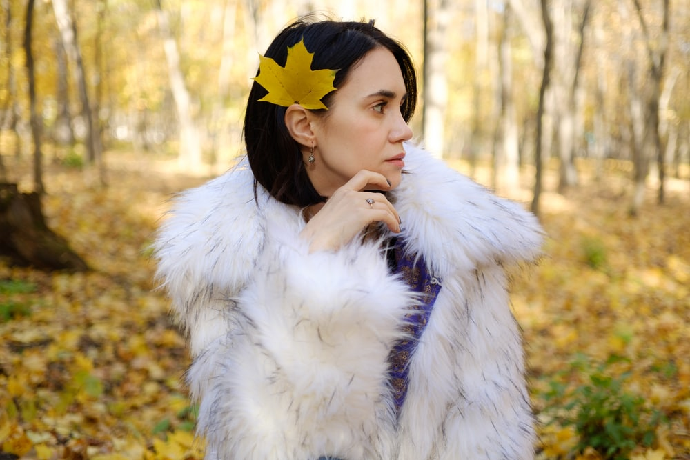 woman wearing white faux fur coat
