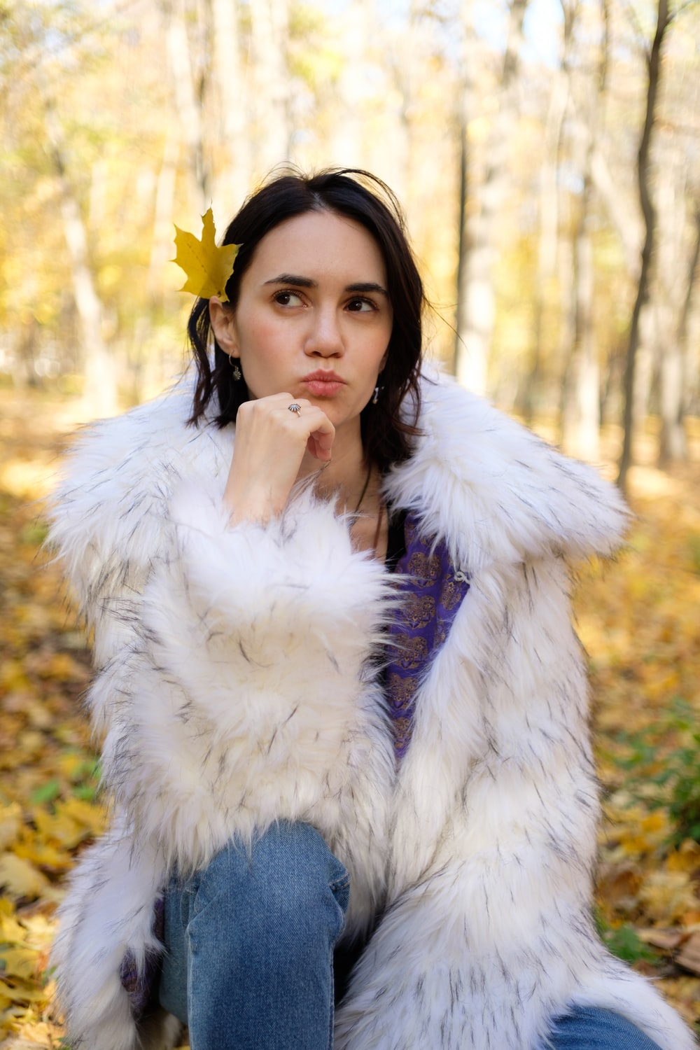 shallow focus photo of woman in white fur jacket