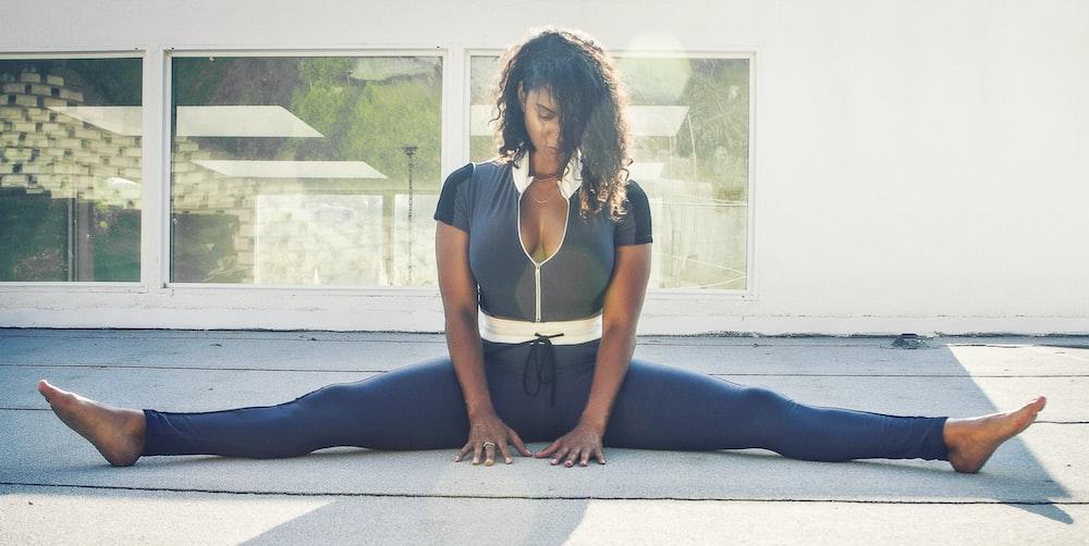 woman doing splits on the floor