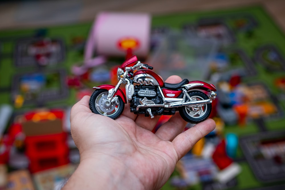 red and black motorcycle scale model