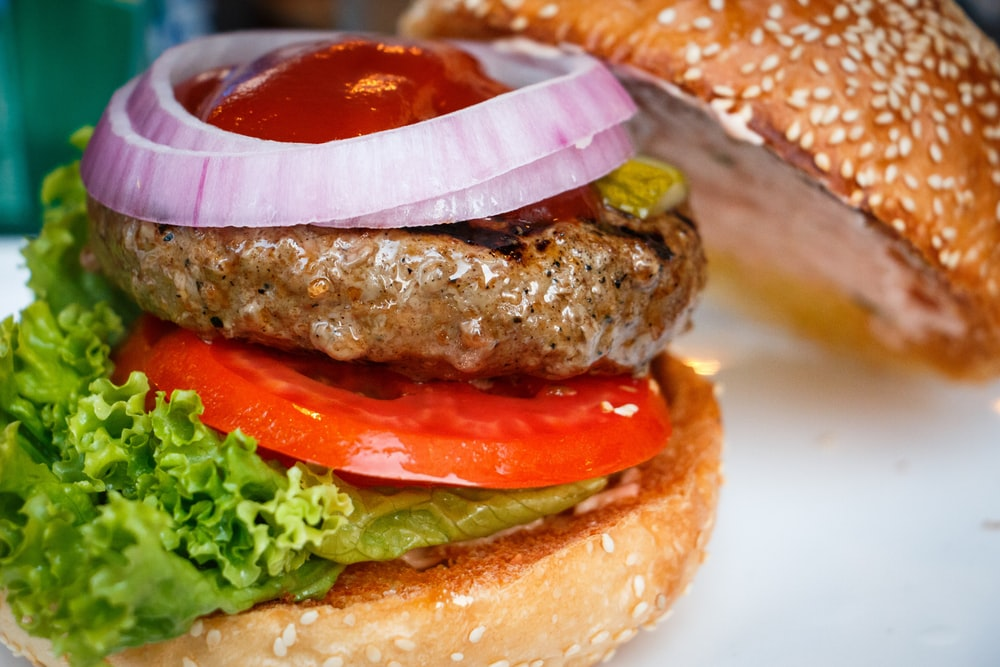 tasty burger with sliced onion and sesdame