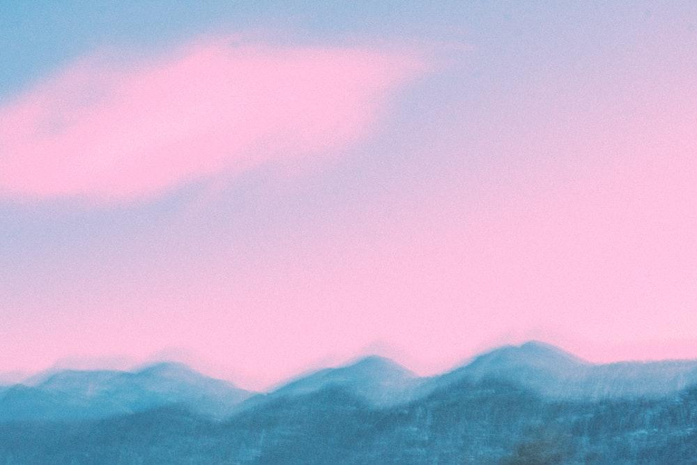 mountain under pinkish sky during daytime