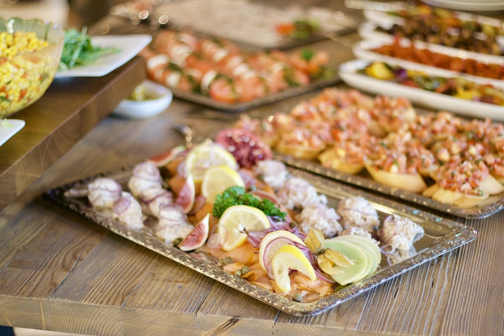 assorted foods on tray on wooden surface