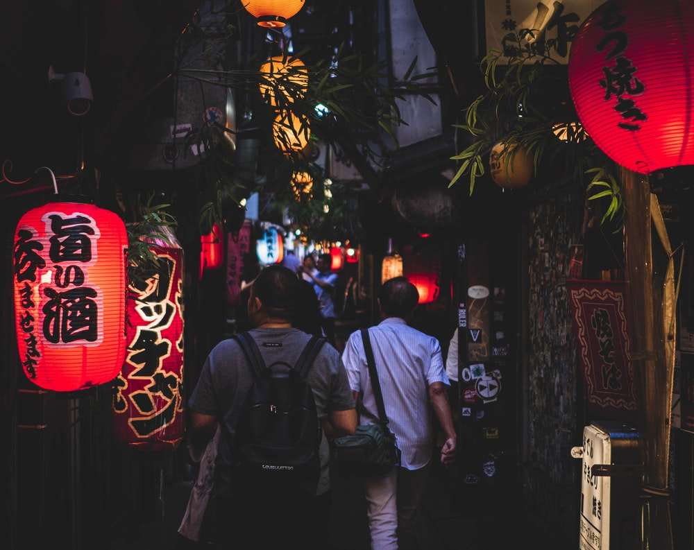 men walking on dark alley