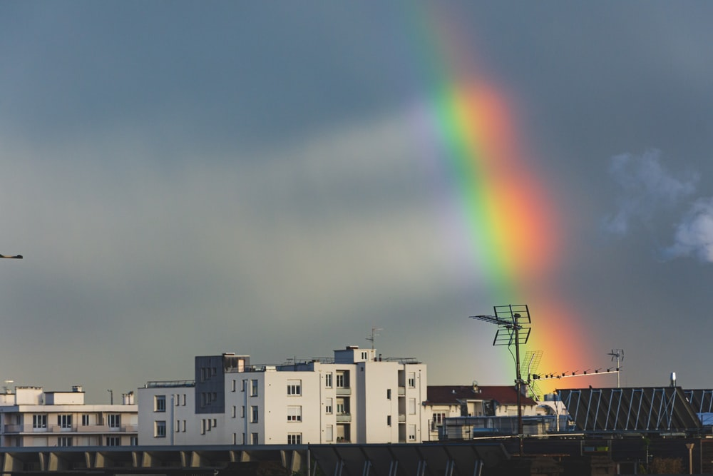 white building and rainbow