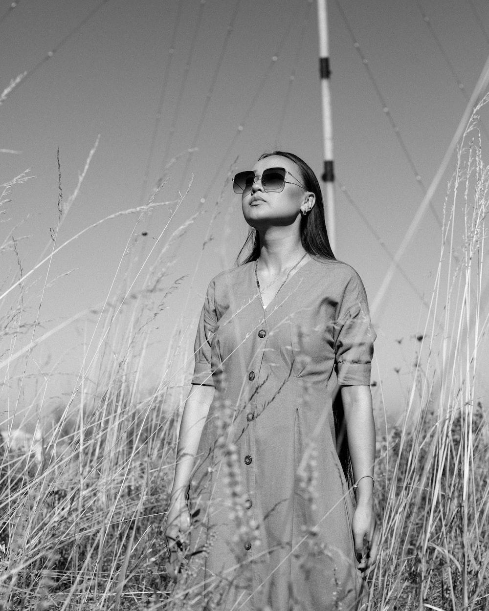 woman standing grass field