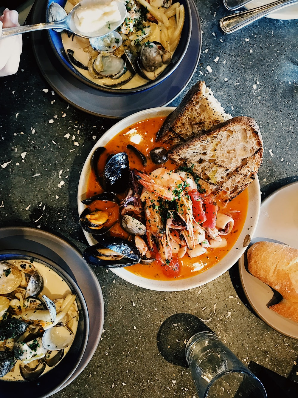 round white ceramic bowl with seafoods