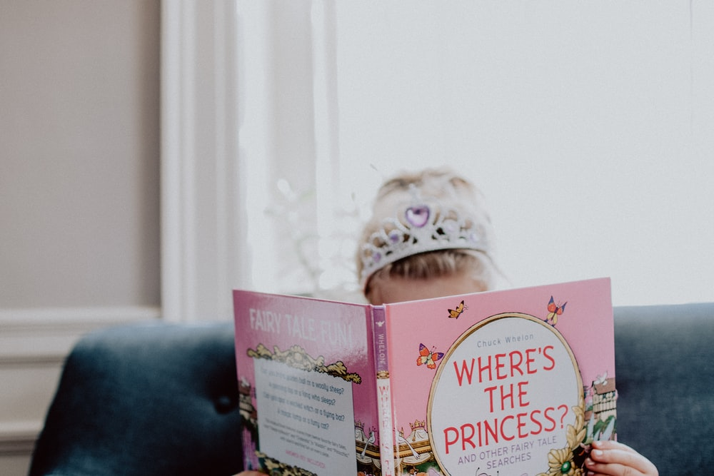 girl reading a pink Princess book
