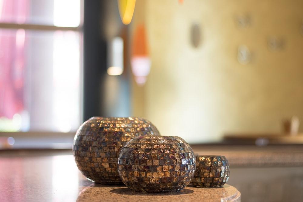 three brown ceramic vases