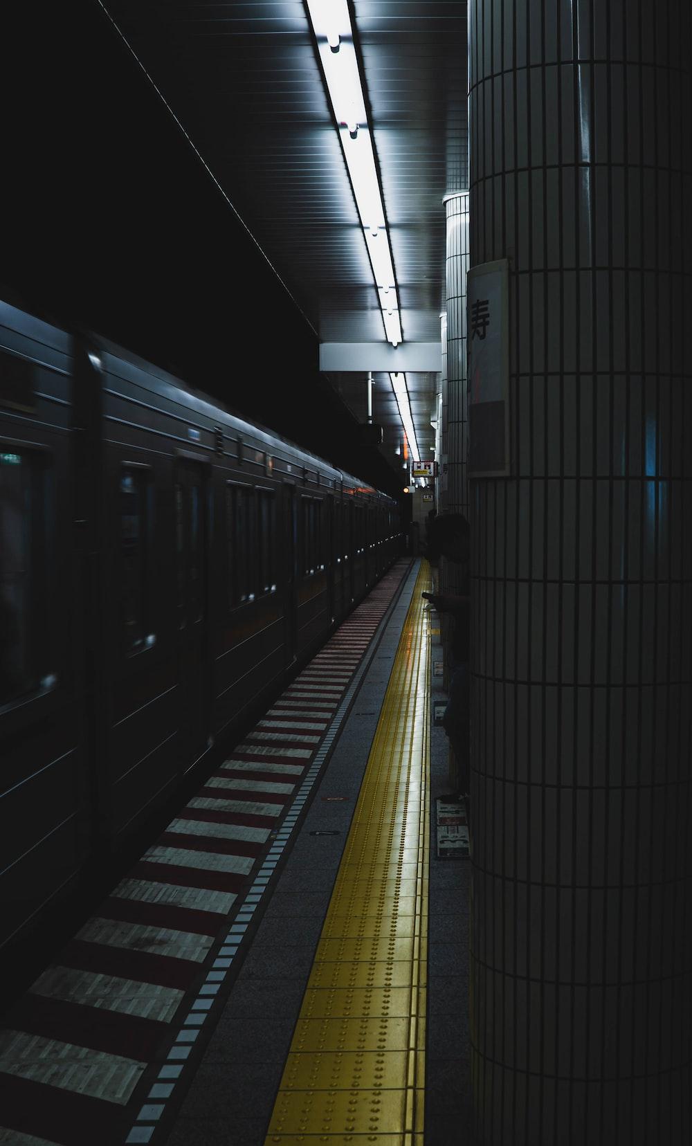 gray and yellow train platform and train
