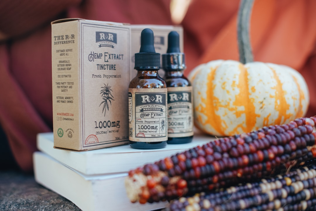 Hemp extract tinctures in a fall and autumn setting.