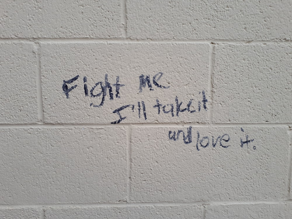 fight me I'll take it and love it sign on wall