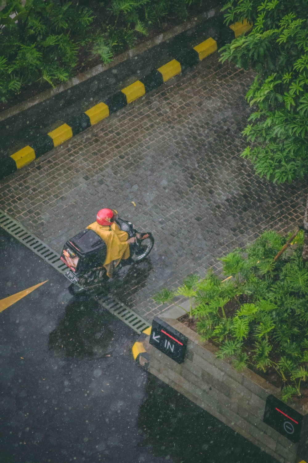 person in red helmet riding motorcycle