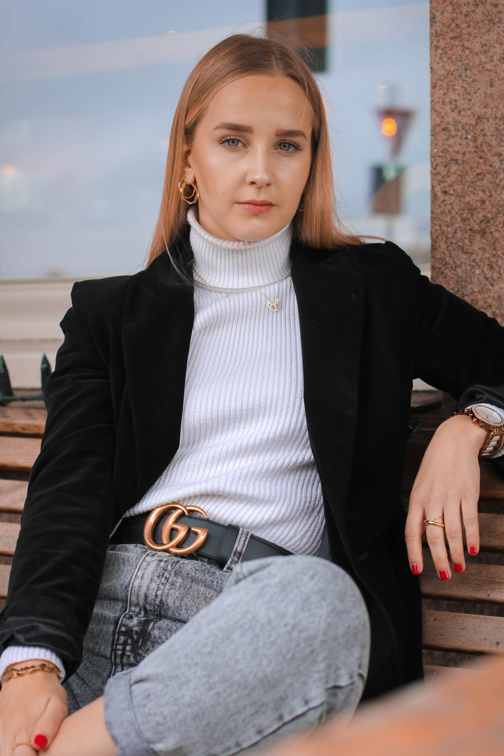 woman sits on bench