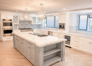 two beige pendant lamps in kitchen