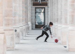 child playing ball on hallway