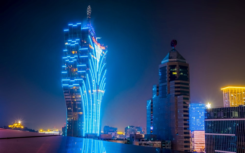 blue and black lit high-rise building