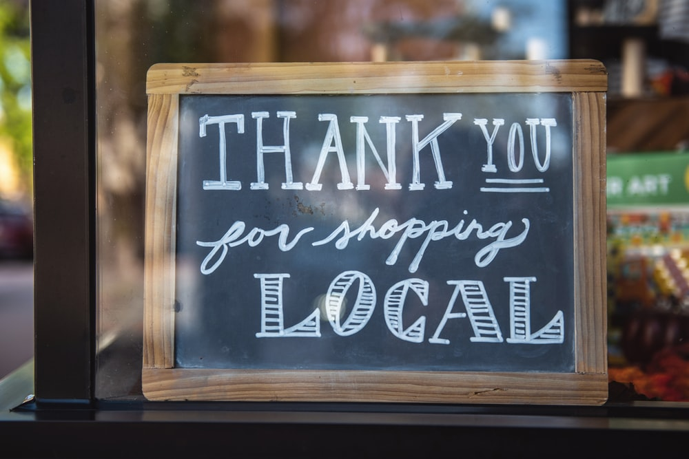 shallow focus photo of thank you for shopping signage