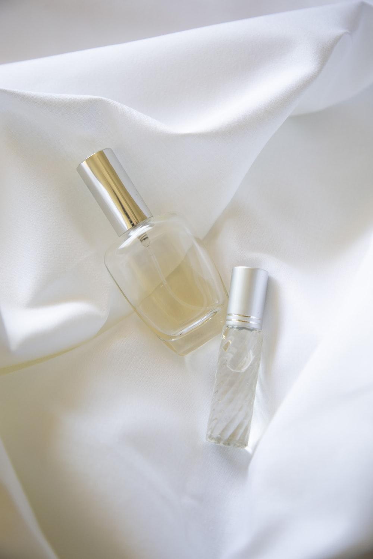 two bottles on white textile