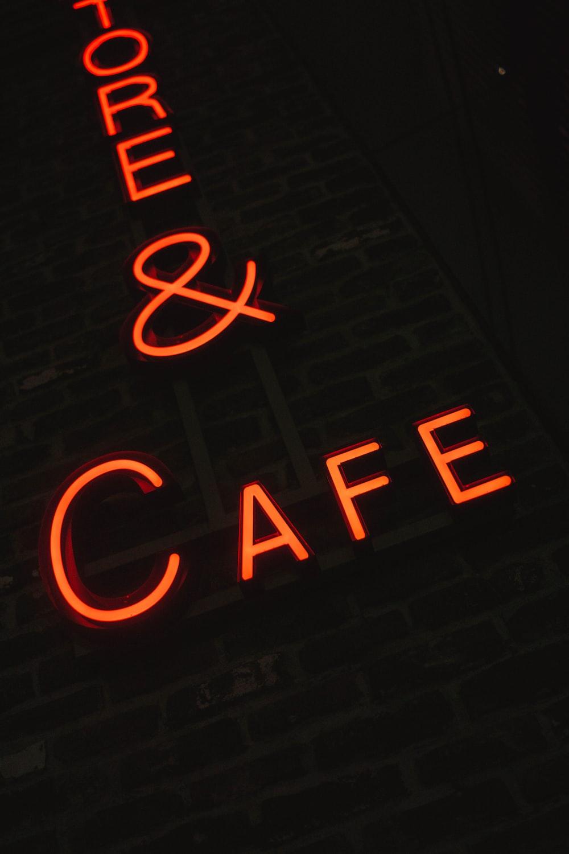 orange neon sign on wall