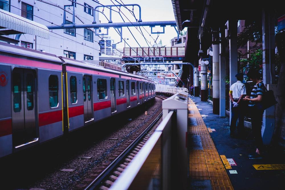 men standing beside train