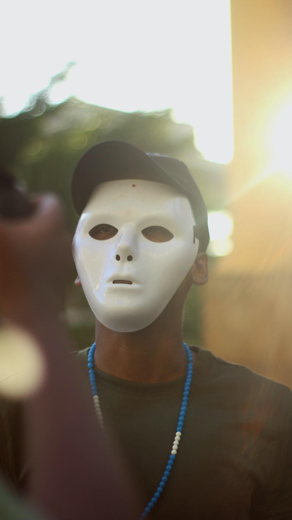 man wearing white mask