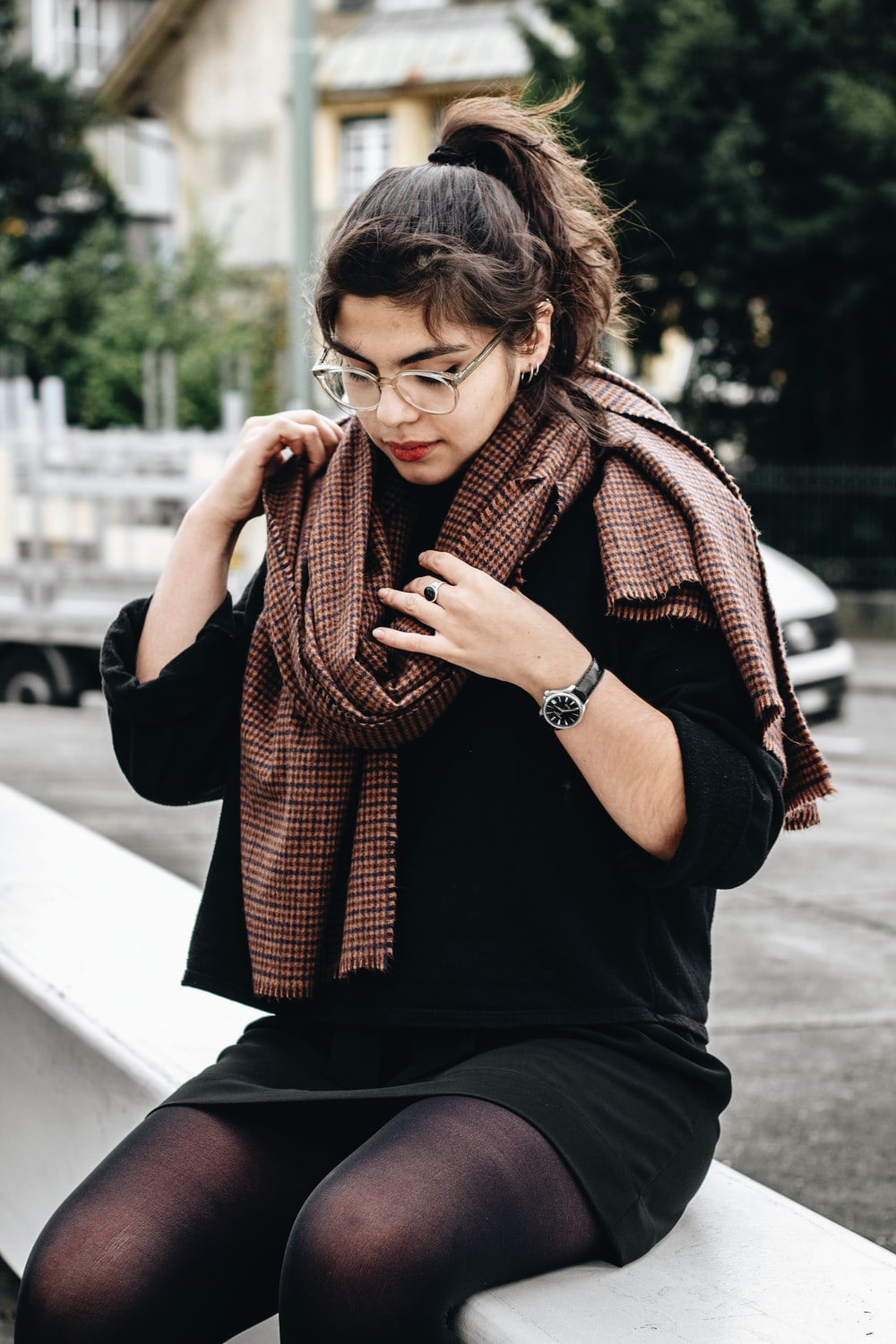 woman wearing black 3/4-sleeved dress and brown scarf