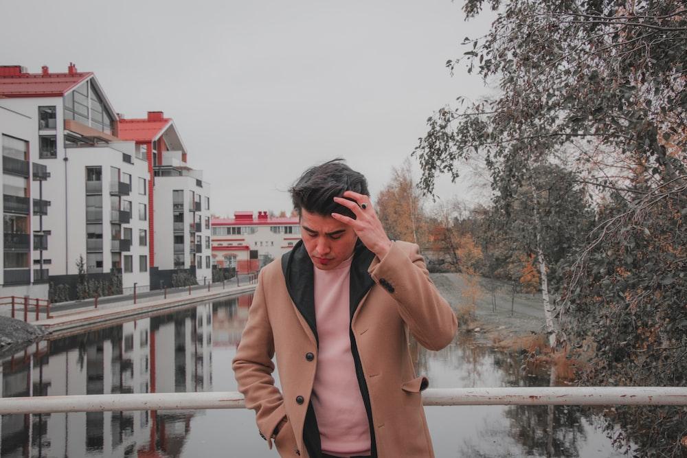 man wearing beige jacket