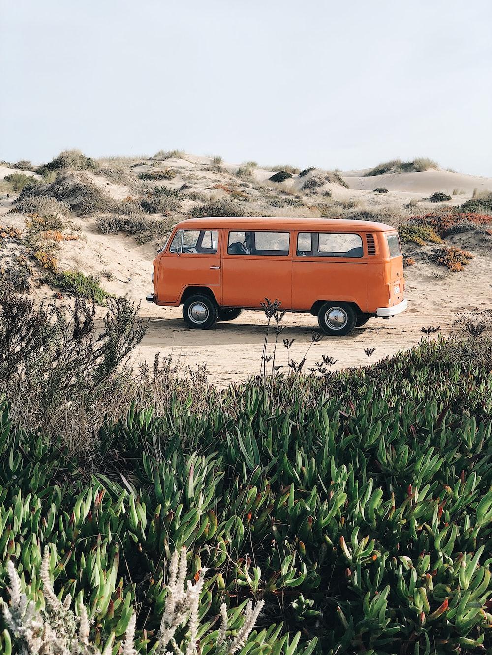 orange minivan on desert