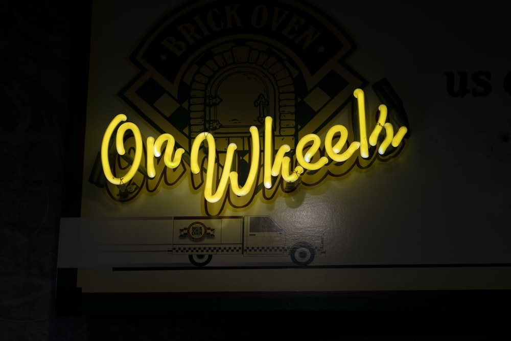turned on On Wheels neon signage