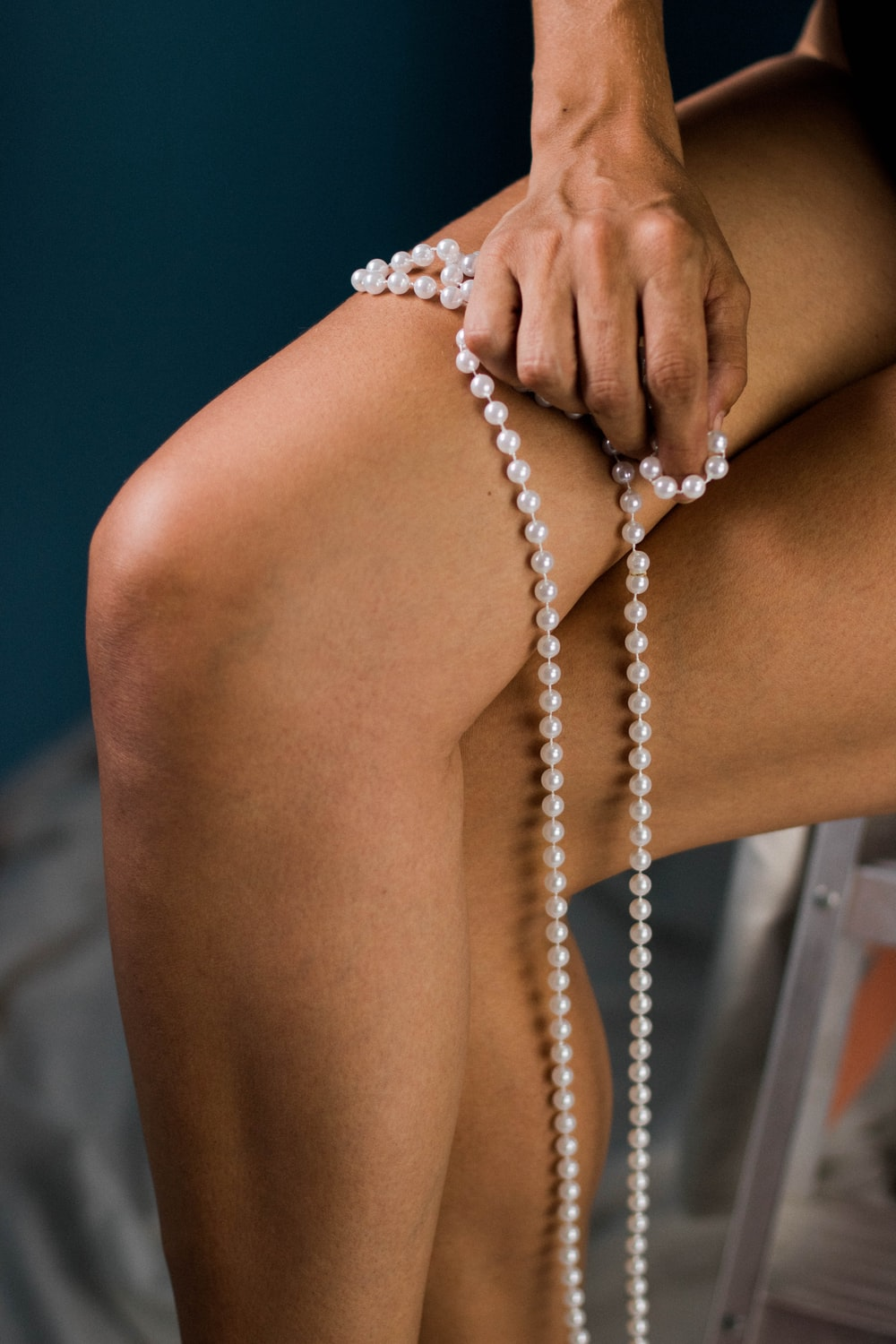 shallow focus photo of person holding white jewelry