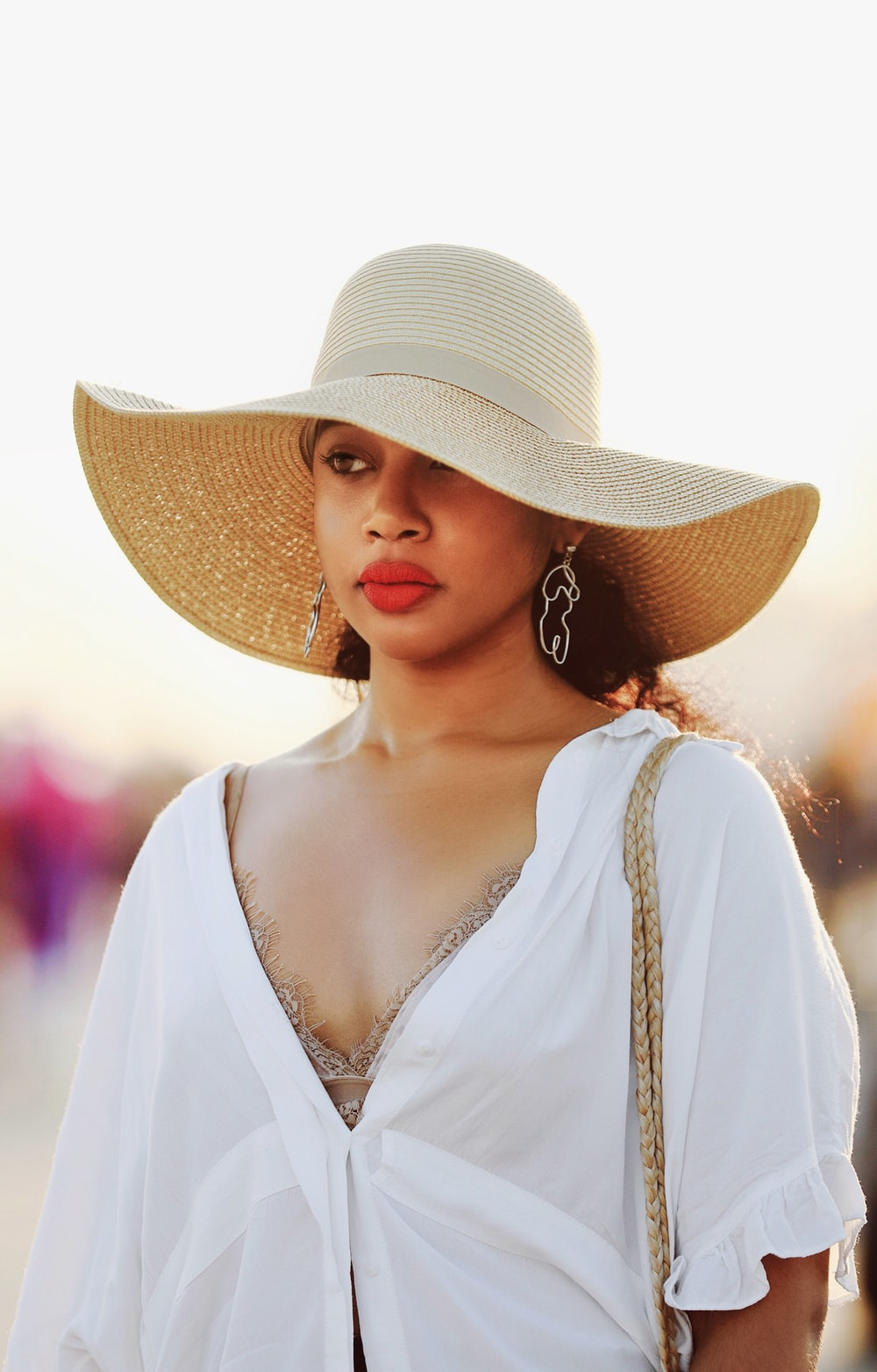 woman wearing brown straw hat and white top