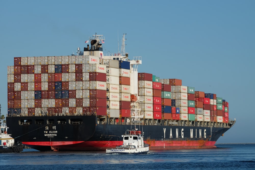 black and red ship on body of water at daytime