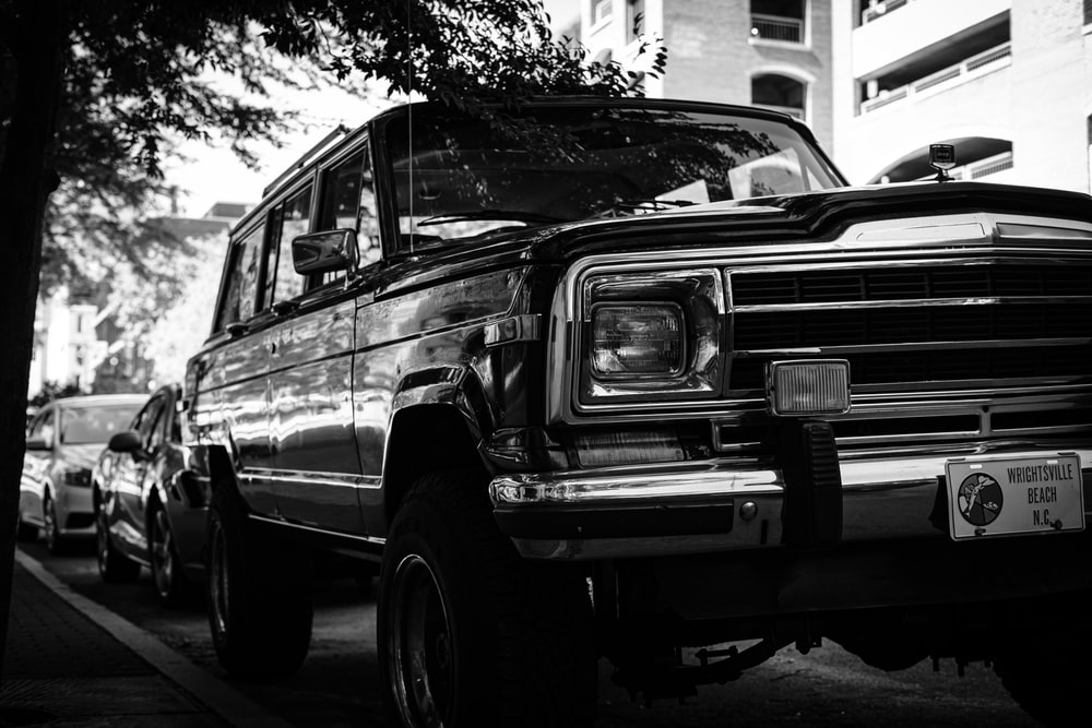 grayscale photography of SUV