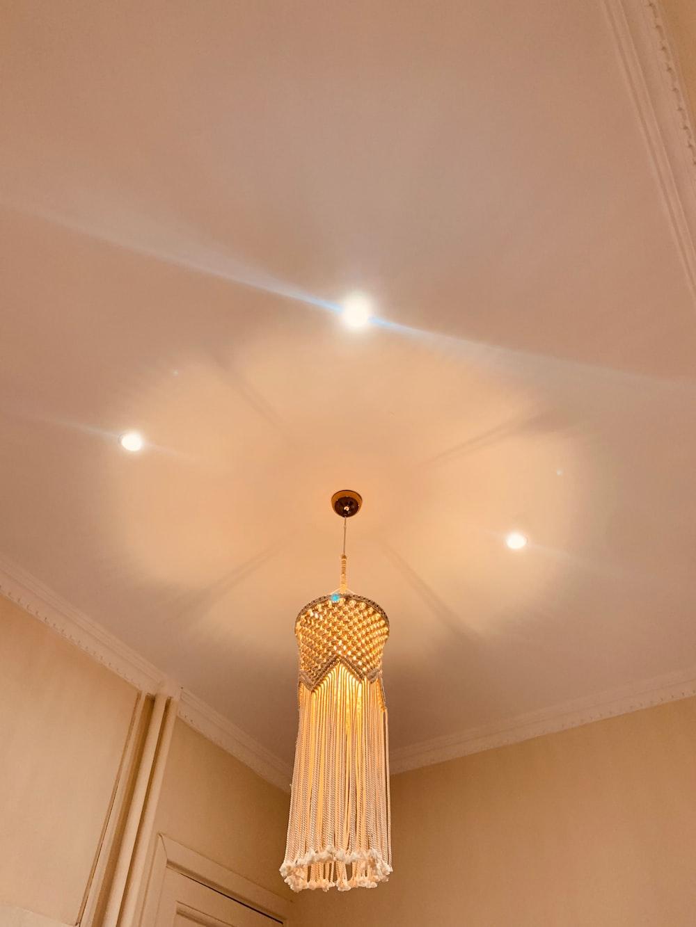 brown ceiling fan turned on