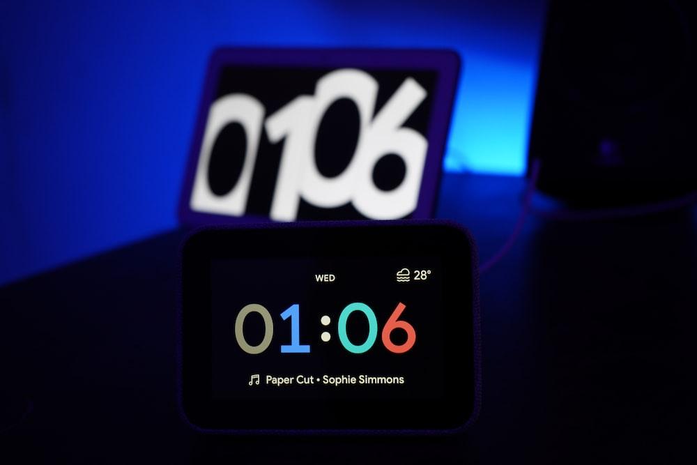 black digital clock at 1:06