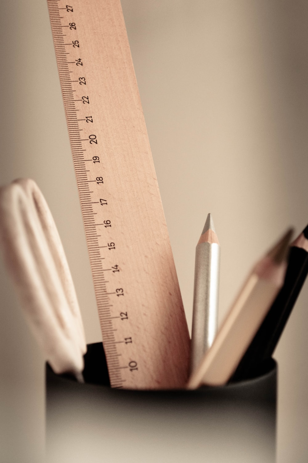 brown wooden ruler and pencil