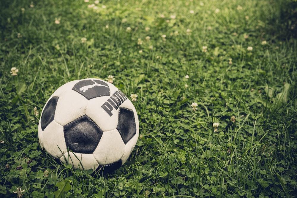 white and black Puma soccer ball