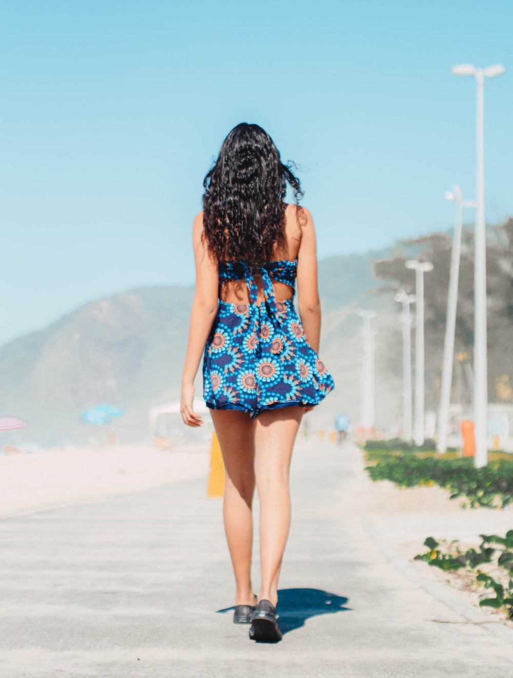 woman wearing blue and brown floral mini dress
